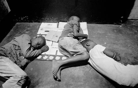 With no home or parental care, street children sleep together for warmth and protection. © 2005 Marcus Bleasdale
