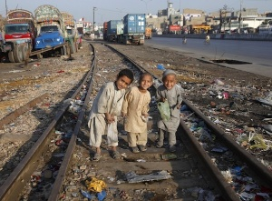 Photo Credit: http://m.theatlanticcities.com/arts-and-lifestyle/2012/12/dumps-train-tracks-and-polluted-water-where-kids-play/4064/